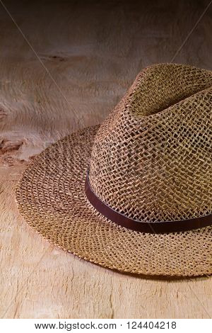 Siesta - straw hat on a wooden table