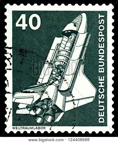 STAVROPOL RUSSIA - APRIL 04 2016: a stamp printed by Germany shows Space Shuttle series Industry and Technology circa 1975