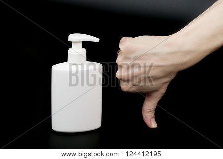 Liquid Soap Dispenser And A Human Hand.closeup