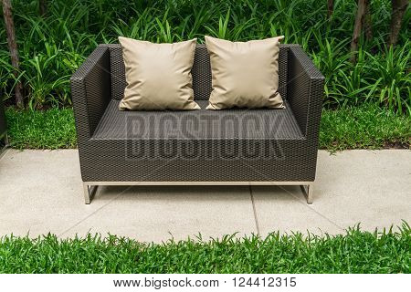 Outdoor patio seating area with Rattan sofa