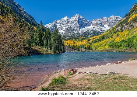 the maroon bells aspen colorado reflected in lake in fall