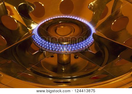gas burner is lit in the dark ** Note: Shallow depth of field