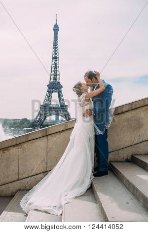Beautiful just married couple in Paris near the Paris attractions