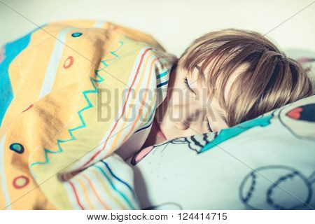 an ordinary day - schoolboy sleep in his bed
