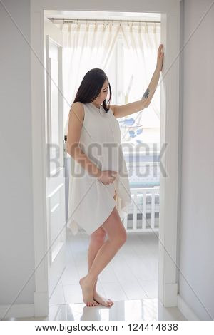 Beautiful Brunette 8 Months Pregnant Woman Posing In Home