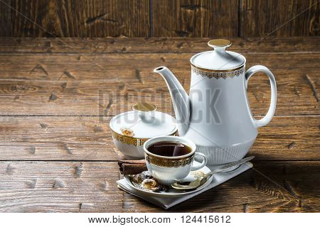 Coffee pot with coffee Cup and sugar bowl on a wooden table