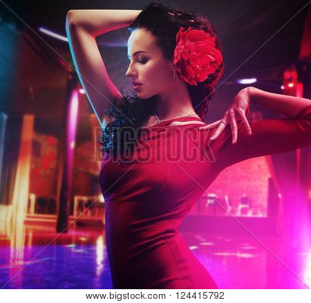 Attractive brunette beauty in a dance pose