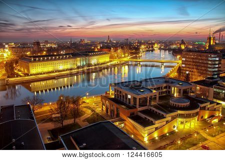 WROCLAW, POLAND - APRIL 02, 2016: Aerial view of Wroclaw. Illuminated city skyline during a beautiful sunset, April 02, 2016 in Wroclaw, Poland.