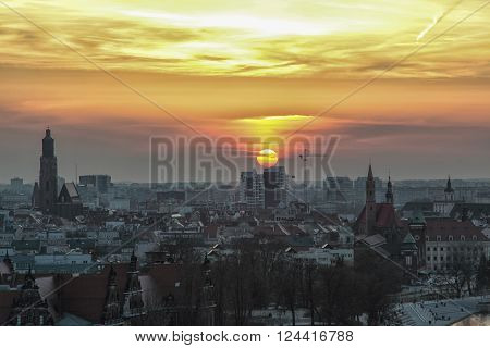 WROCLAW POLAND - APRIL 02 2016: Aerial view of Wroclaw. City skyline Churches and buildings in the old town during a beautiful sunset April 02 2016 in Wroclaw Poland.