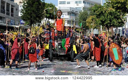 LIMASSOL CYPRUS - MARCH 13 : Happy people in teams dressed with colorful costumes at famous Limassol Carnival Parade on March 13 2016 in Limassol town Cyprus.