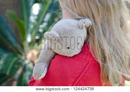 Little girl hugging her cute teddy tightly