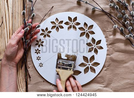 Master Class. Watch handmade. Step by step instructions for the manufacture of clocks. Hands with paint brush base clock of white paint. Willow branches against