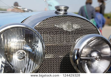 Goes, Netherlands - May 19, 2013: Radiator grill and badge of a vintage Morgan