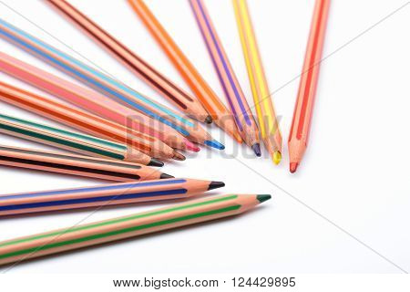 Close Up Picture Of Colored Pencil Crayons With Stripes On White Background. Assortment Of Colored P