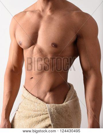 Torso of a male bodybuilder in a towel