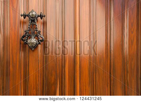Authentic vanished Spanish door and black iron knocker. for use of copy space text and background.