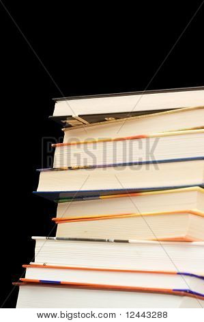 Pile Of Old Books On A Black Background