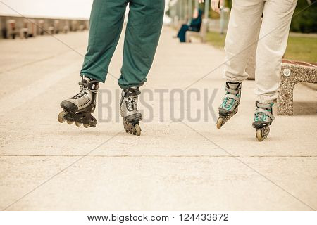 Friends Outdoors Have Fun Rollerblading Together.
