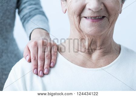 Image of senior with positive attitude during therapy