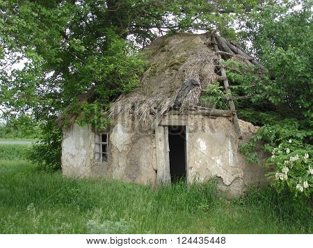 abandoned clay house, broken peasant country house