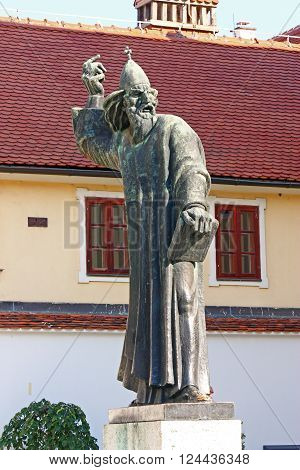CROATIA VARAZDIN 31 AUGUST 2013: Statue of Gregory of Nin medieval Croatian bishop of Nin who introduced the national language in the religious services Varazdin Croatia