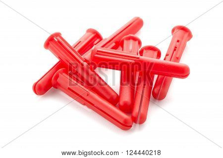 Red plastic dowels isolated on white background.