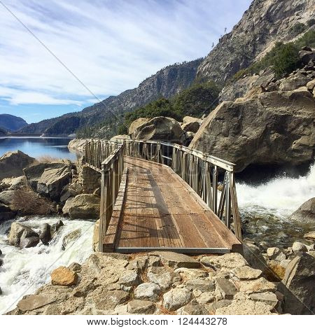 Footbridge over Wapama Falls at in the Hetch Hetchy Valley, California