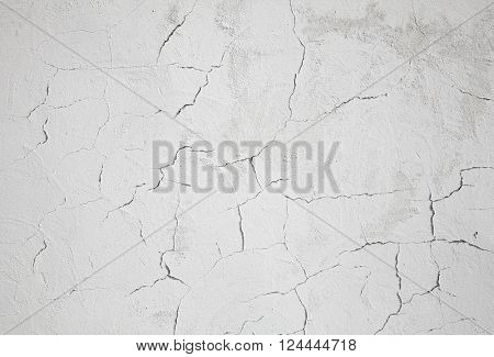 white textured wall with cracks