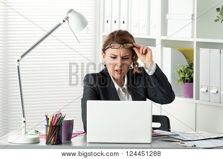 Portrait Of Surprised Businesswoman Looking At Laptop Screen