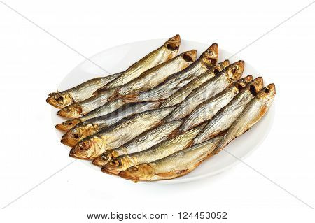 Plate with smoked Baltic sprat isolated on white background