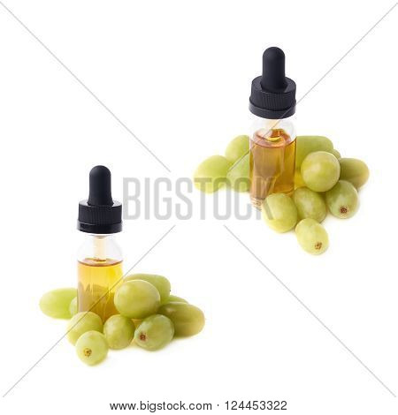 Grape seed oil essence in a small bottle with a pipette, surrounded with the multiple white table grapes, composition isolated over the white background, set of two foreshortenings