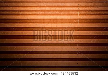 Modern and brown pleated blinds, texture with shadows