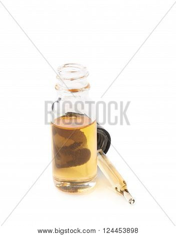 Small medical bottle with a pipette, filled with transparent yellow liquid isolated over the white background