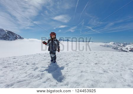 Cute Little Skier And Alpine Panorama.
