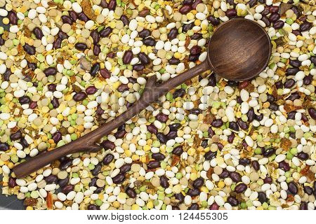 varicoloured bean , peas mix with spices and wooden spoon ** Note: Visible grain at 100%, best at smaller sizes