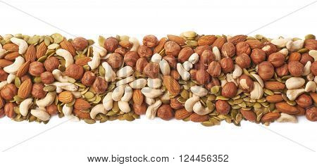 Line border made of multiple different nuts and seed mix, composition isolated over the white background