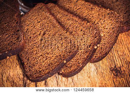 Russian loaf of rye flour on wooden background