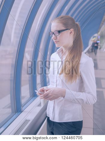 business woman in glasses  It is located in an office window ** Note: Soft Focus at 100%, best at smaller sizes