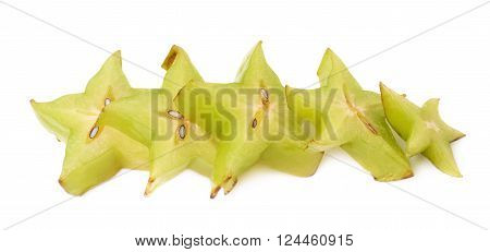 Line of multiple Averhhoa carambola starfruit slices isolated over the white background