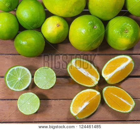 Fresh Citric Fruit. Lemon and Orange on wood board