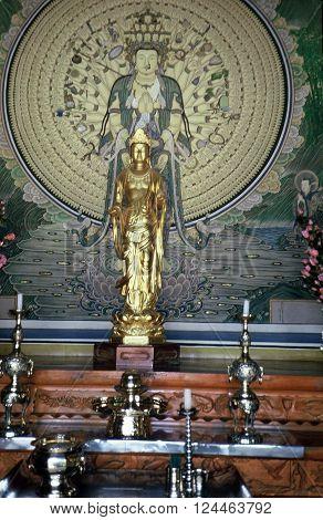 GYEONGJU CITY, NORTH GYEONGSANG PROVINCE / KOREA - CIRCA 1987: A Buddhist image stands on an altar in the Bulguksa Buddhist Temple.