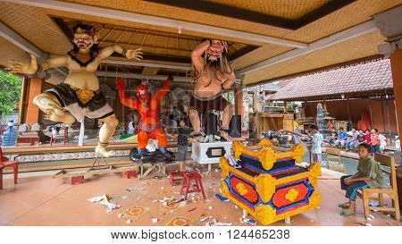 UBUD, INDONESIA - MAR 5, 2016: Unidentified local children during building of Ogoh-ogoh statues for the Ngrupuk parade, which takes place on eve of Nyepi day. Nyepi is a public holiday in Indonesia.