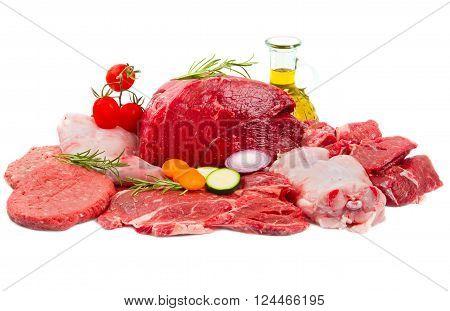 some Fresh butcher cut meat assortment garnished