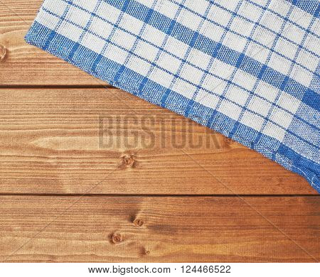 Blue tablecloth or towel over the surface of a brown wooden table