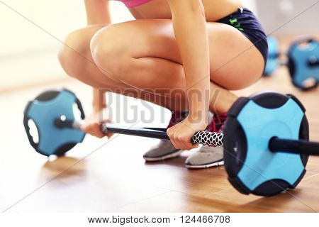 Picture of woman working out with weights in gym