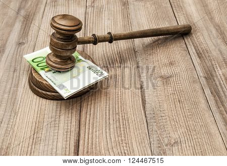 Auctioneer hammer with soundboard. Judges gavel and euro banknotes