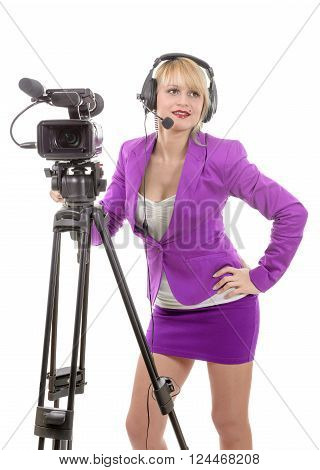 beautiful young woman with a professional video camera and headphone