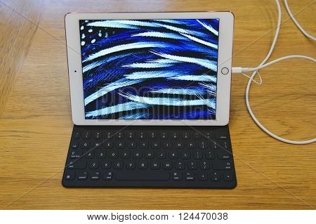PARIS FRANCE - APR 4 2016: Screensaver on the new Apple iPAd Pro during the sales launch of the latest Apple Inc. smartphone and iPad Pro at the Apple store in Paris France