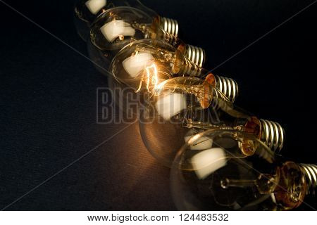 Bright Light Bulb close up shot dark background