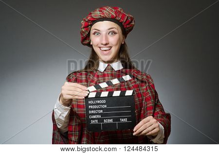 Woman in scottish clothing in movie concept